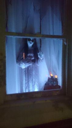 girl ghost in window